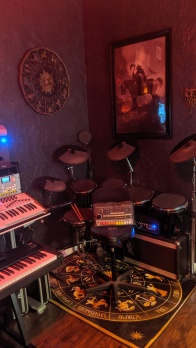 Alesis DM-10x with Peavy Monitor MIDI'd up to Addictive Drums, EZ Drummer, Korg M1, etc.